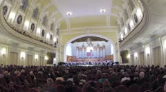 People enjoying the Concerto Grosso concert - stock footage