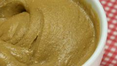 Churning peanut butter, Slow Motion Stock Footage
