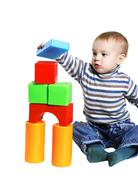 little boy builds a house out of toy blocks - stock photo