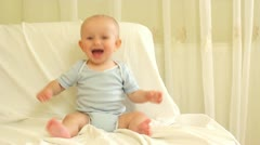 Adorable baby laughing and clapping hands - stock footage