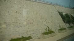 Speeding train travel,scenery outside window.Villages tree & Guardrail. - stock footage