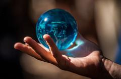 Crystal ball in hand Stock Photos