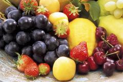 Fruit still life with grapes, cherries, strawberries etc. - stock photo