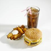 Cheeseburger, potato wedges and cola Stock Photos