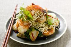 Bami Goreng with shrimps and chicken (Indonesia) Stock Photos