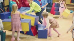 Adult girl in pirate suite, children plays during birthday party Stock Footage