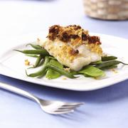 Baked cod on beans - stock photo