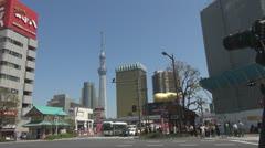 Take photo to Sumida street traffic and Sky Tree, Tokyo, Japan Stock Footage