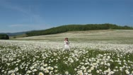 Girl with a bouquet of daisies Stock Footage