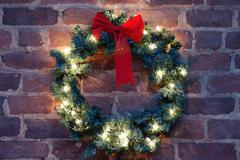 Christmas wreath on brick wall Stock Photos