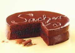 Sacher torte with the word 'Sacher', a piece cut Stock Photos