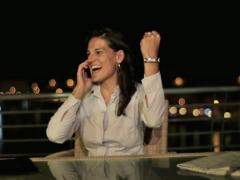 Excited, happy, successful businesswoman on terrace, crane shot NTSC - stock footage