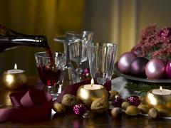 Table with Christmas decorations and red wine Stock Photos
