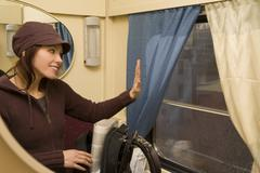 Young woman travel in passenger roomette Stock Photos