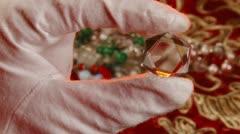 Jeweler looks through the lens Stock Footage
