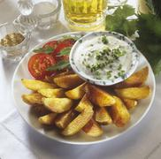 Spicy potato wedges with dip - stock photo