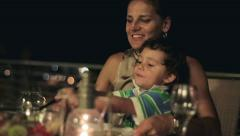Happy family eating dinner in the evening, steadicam shot HD Stock Footage