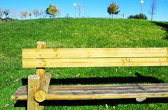 Wooden chair in portuguese park Stock Photos