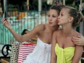 Stock Video Footage of Girlfriends taking photo with cellphone in the city, steadicam shot NTSC