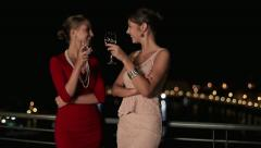 Happy girlfriends raising toast on party, steadicam shot HD - stock footage