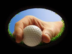 golf ball with hand - stock photo