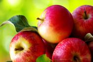 Stock Photo of ripe red apples on table