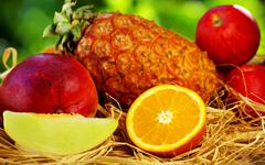 Fruits on green background Stock Photos