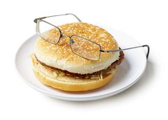 Amusing sandwich in spectacles isolated on a white background Stock Photos