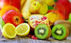 Kiwi and lemon fruits Stock Photos