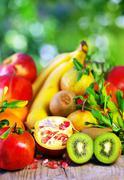 Kiwi , pomegranates and variety fruits Stock Photos