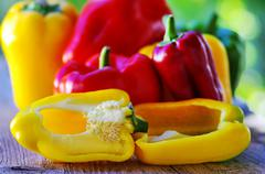Red, yellow and green pepper on table Stock Photos