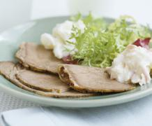 Cold roast beef with salad - stock photo
