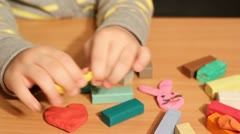 Little girl play with plasticine Stock Footage