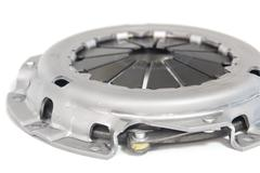 clutch plate just removed from a car showing wear out - stock photo