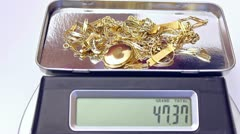 gold jewelry on a digital scale - stock footage