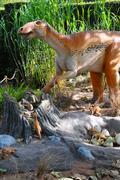edmontosaurus dinosaur with babys in nest site - stock photo