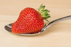 Stock Photo of strawberry on metal spoon