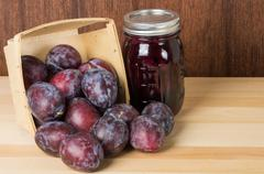 prune plums with jar of jam - stock photo