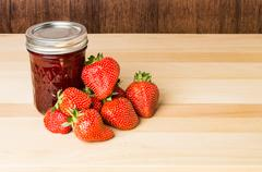 fresh strawberries and strawberry jam - stock photo