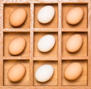 Stock Photo of eggs in shadow box vertical