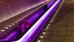 Timelapse of unidentified shoppers riding an escalator at a shopping centre Stock Footage