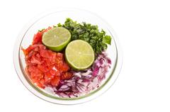 ingredients for fresh salsa in clear bowl - stock photo