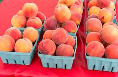 baskets of peaches for sale at the market - stock photo