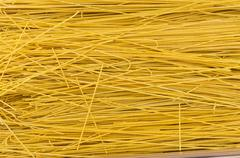 fresh thin pasta on display at the market - stock photo