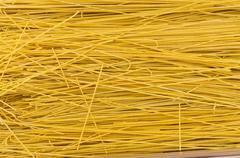 fresh thin pasta on display at the market - stock photo