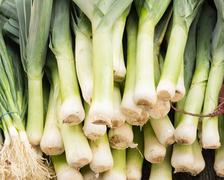 leeks on display at the market - stock photo