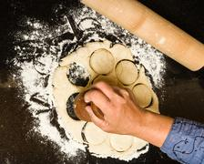 cutting biscuits from rolled dough - stock photo