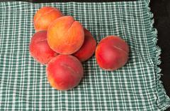 fresh peaches on cloth - stock photo
