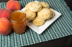 Plate of biscuits with peaches and jelly Stock Photos