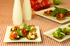 Fresh bruschetta with tomatoes cheese basil Stock Photos